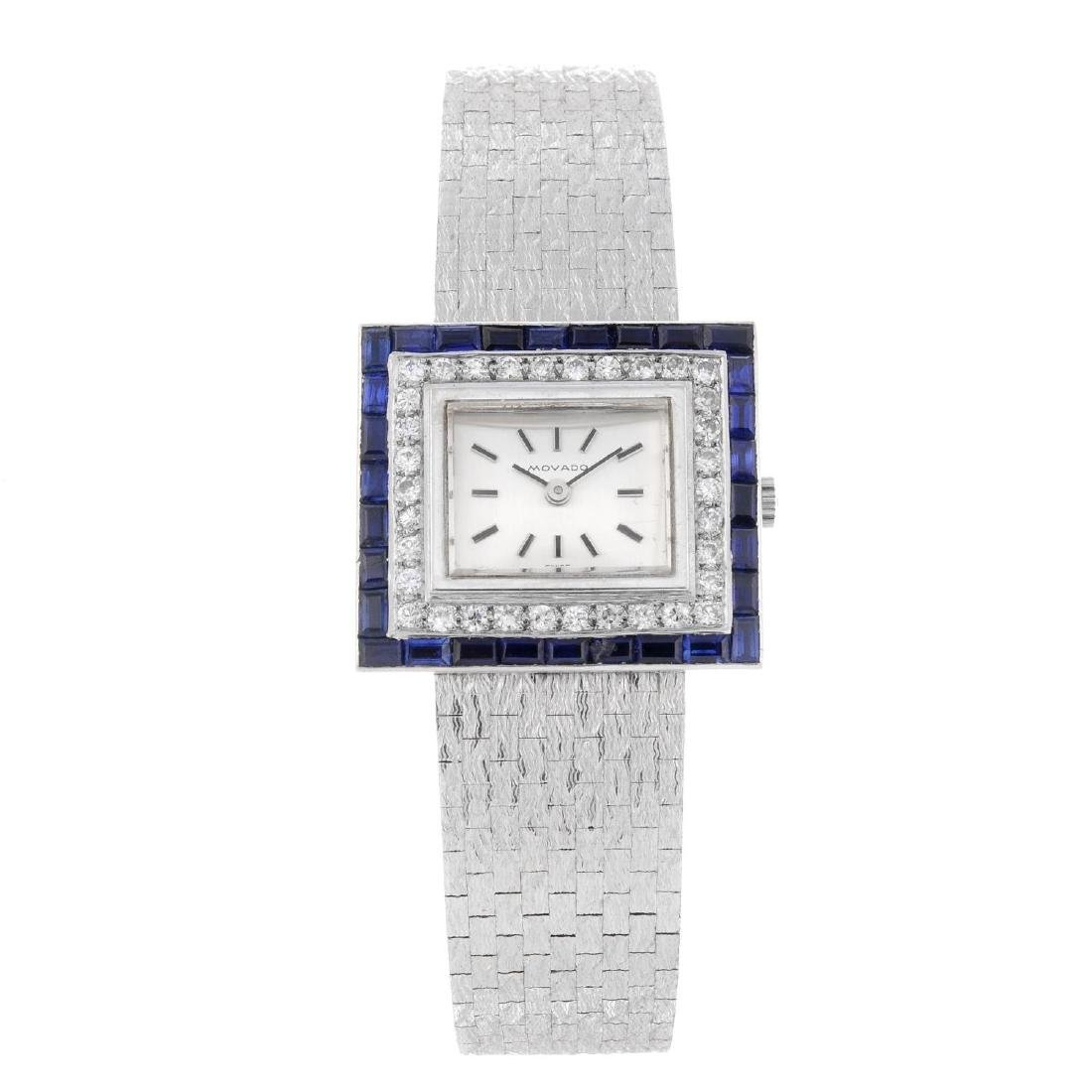 MOVADO - a lady's bracelet watch. White metal case with