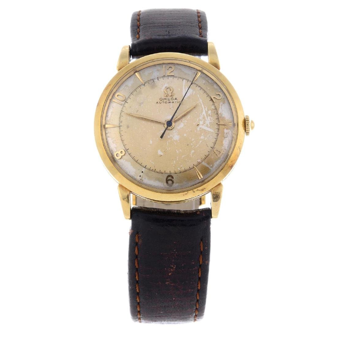OMEGA - a gentleman's wrist watch. Yellow metal case,
