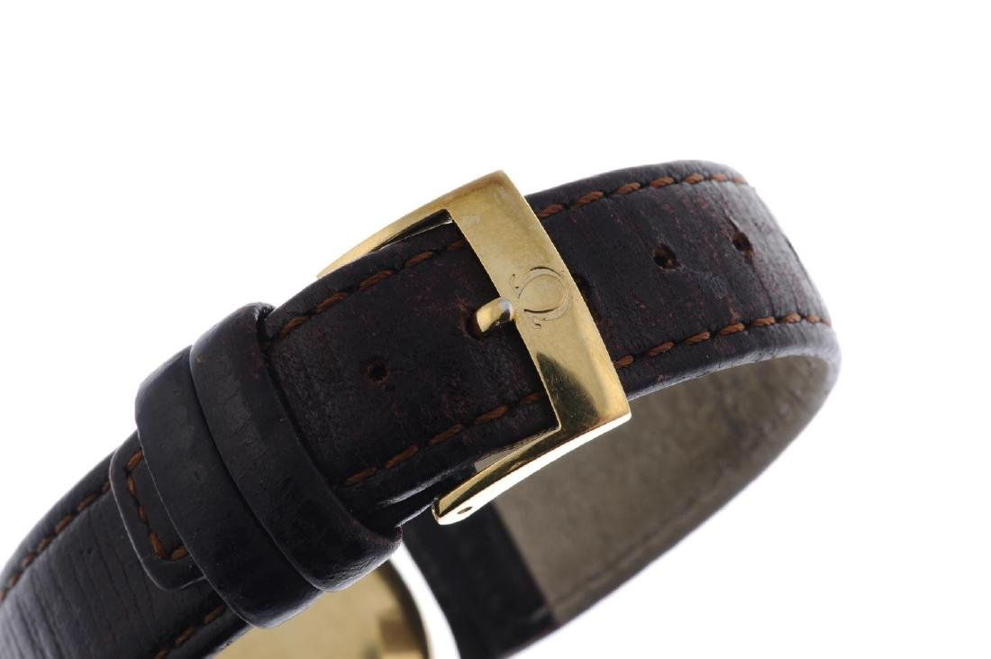 OMEGA - a gentleman's wrist watch. Yellow metal case, - 2