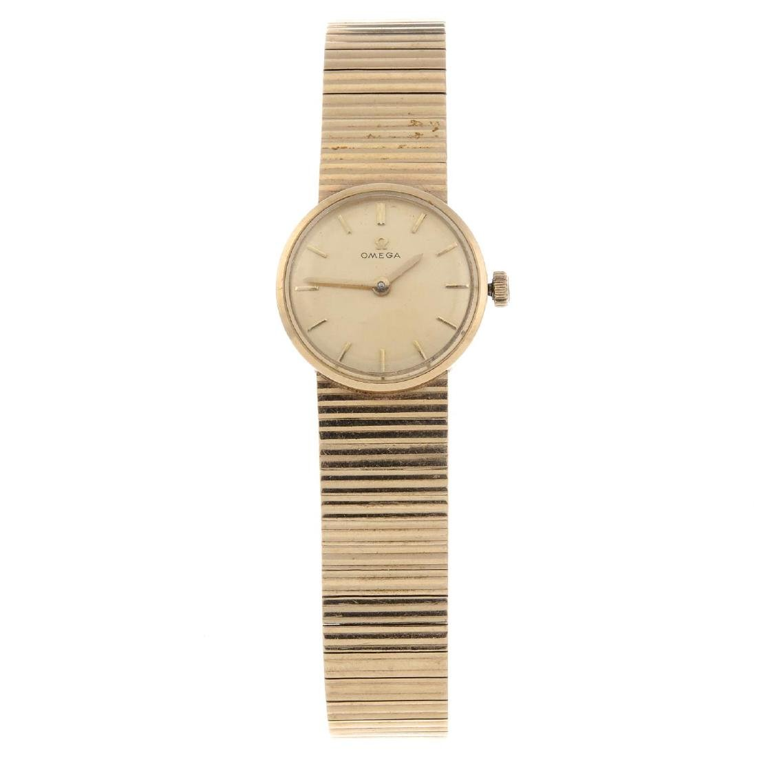 OMEGA - a lady's bracelet watch. 9ct yellow gold case,