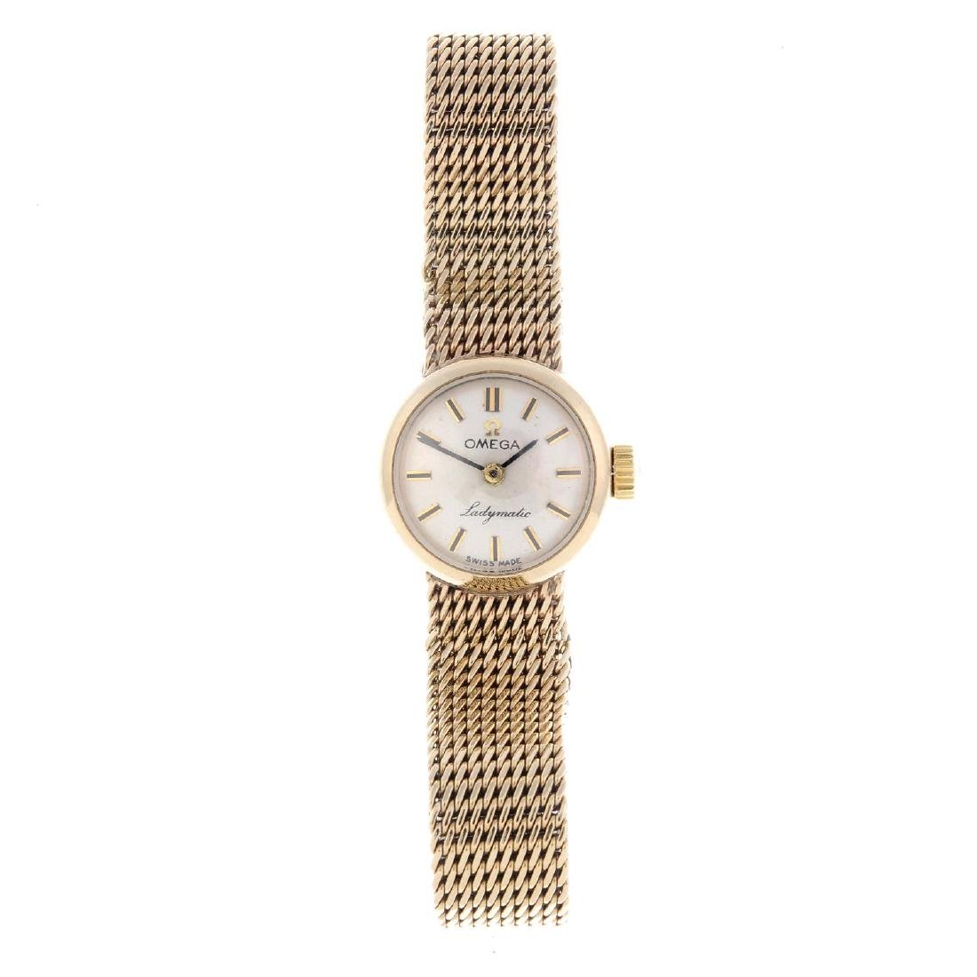 OMEGA - a lady's Ladymatic bracelet watch. Yellow metal