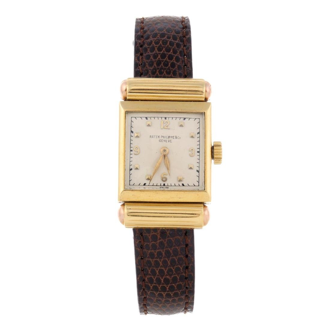 PATEK PHILIPPE - a lady's wrist watch. Yellow metal