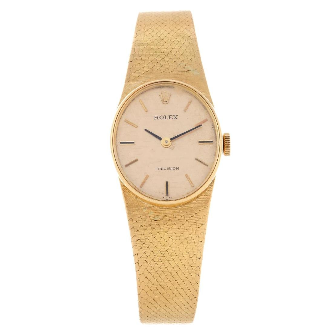 ROLEX - a lady's Precision bracelet watch. Yellow metal