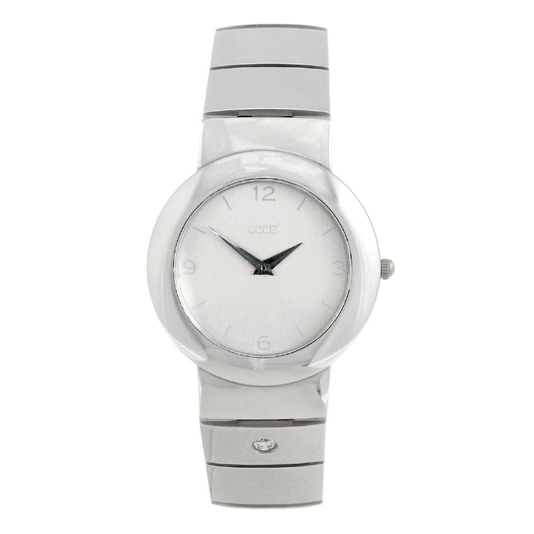 CEDE - a bracelet watch. White metal case, stamped