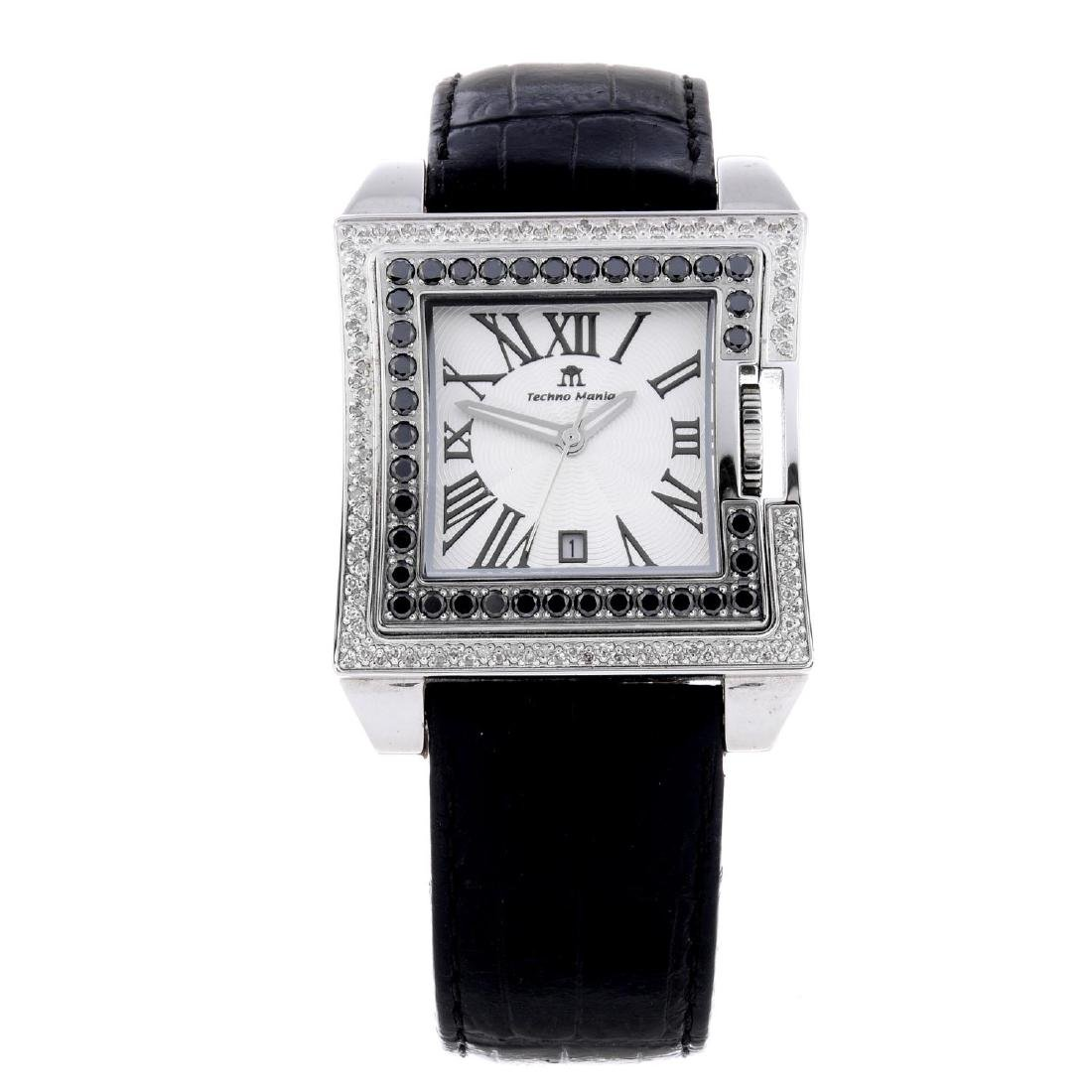 TECHNO MANIA - a wrist watch. Stainless steel case with