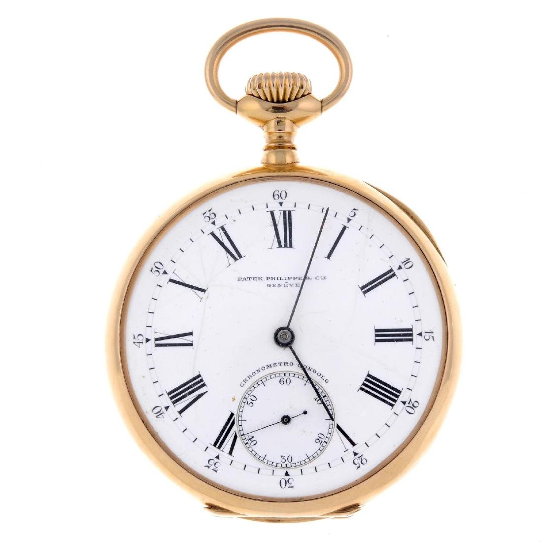 An open face pocket watch by Patek Philippe. Yellow