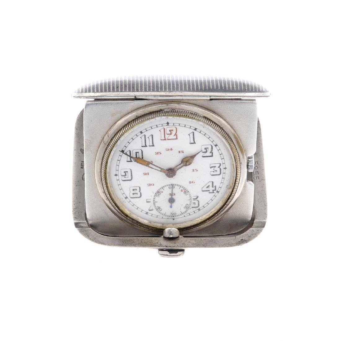 A travel clock. White metal case, stamped 0.800.
