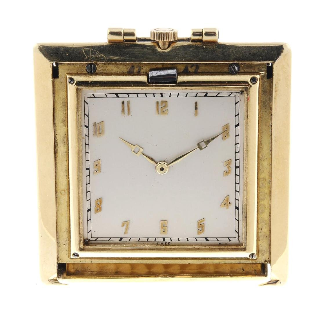 A travel clock by Vacheron Constantin. Yellow metal
