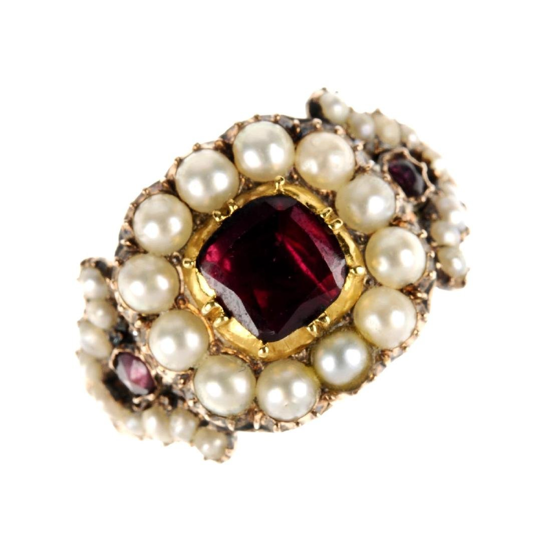 An early 19th century gold garnet and split pearl ring.
