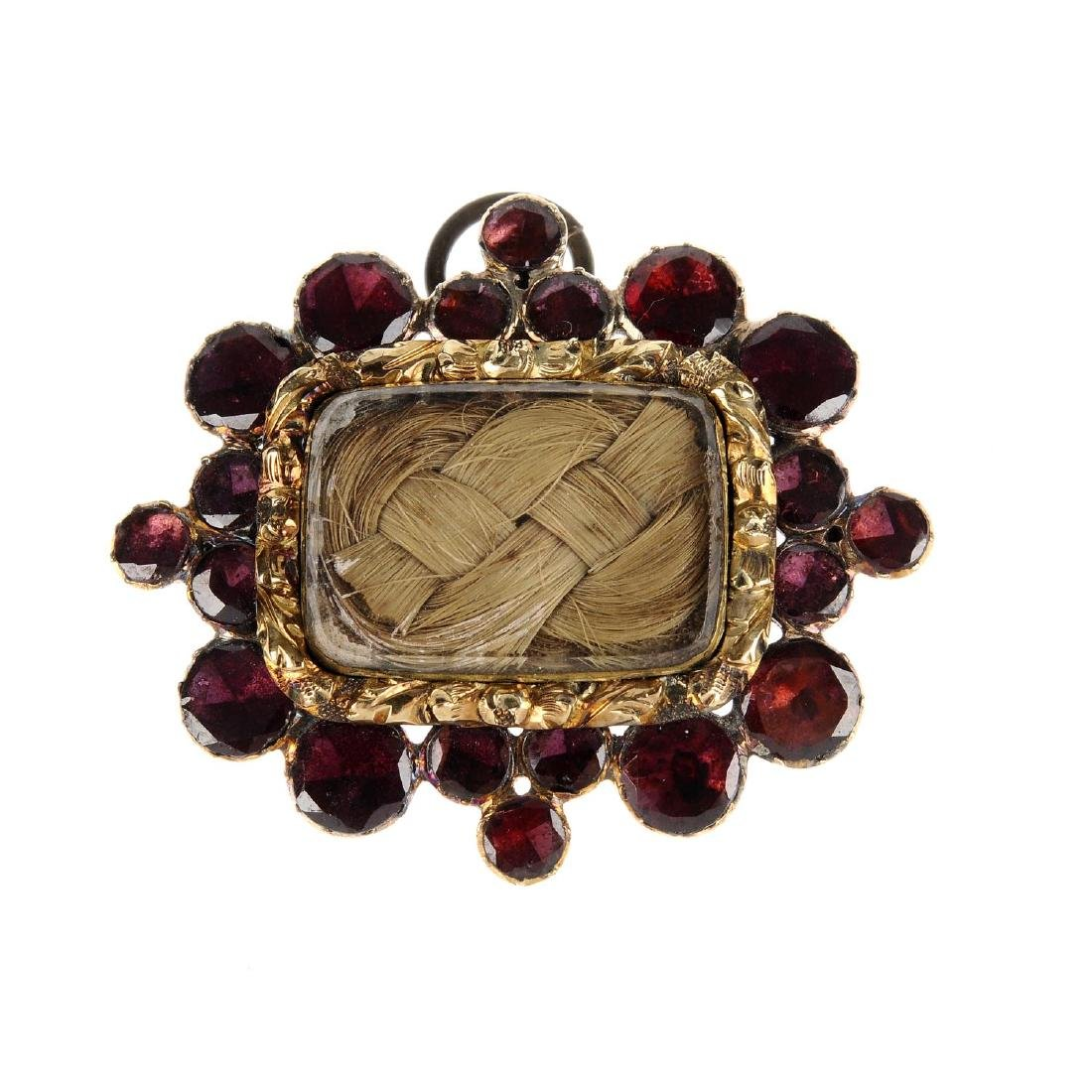 An early Victorian garnet and hair memorial brooch. Of
