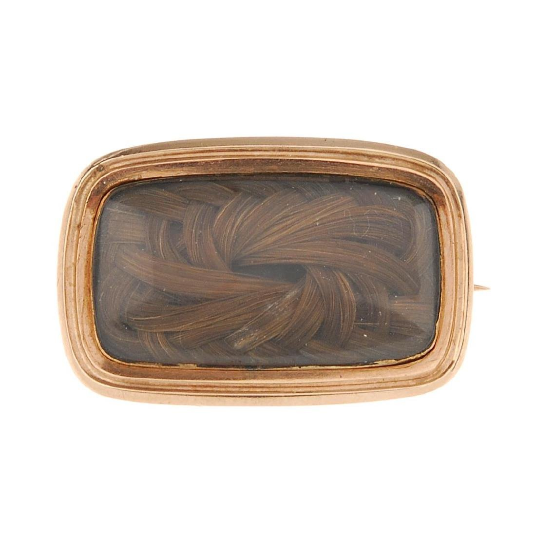 A mid Victorian memorial brooch. Of rectangular