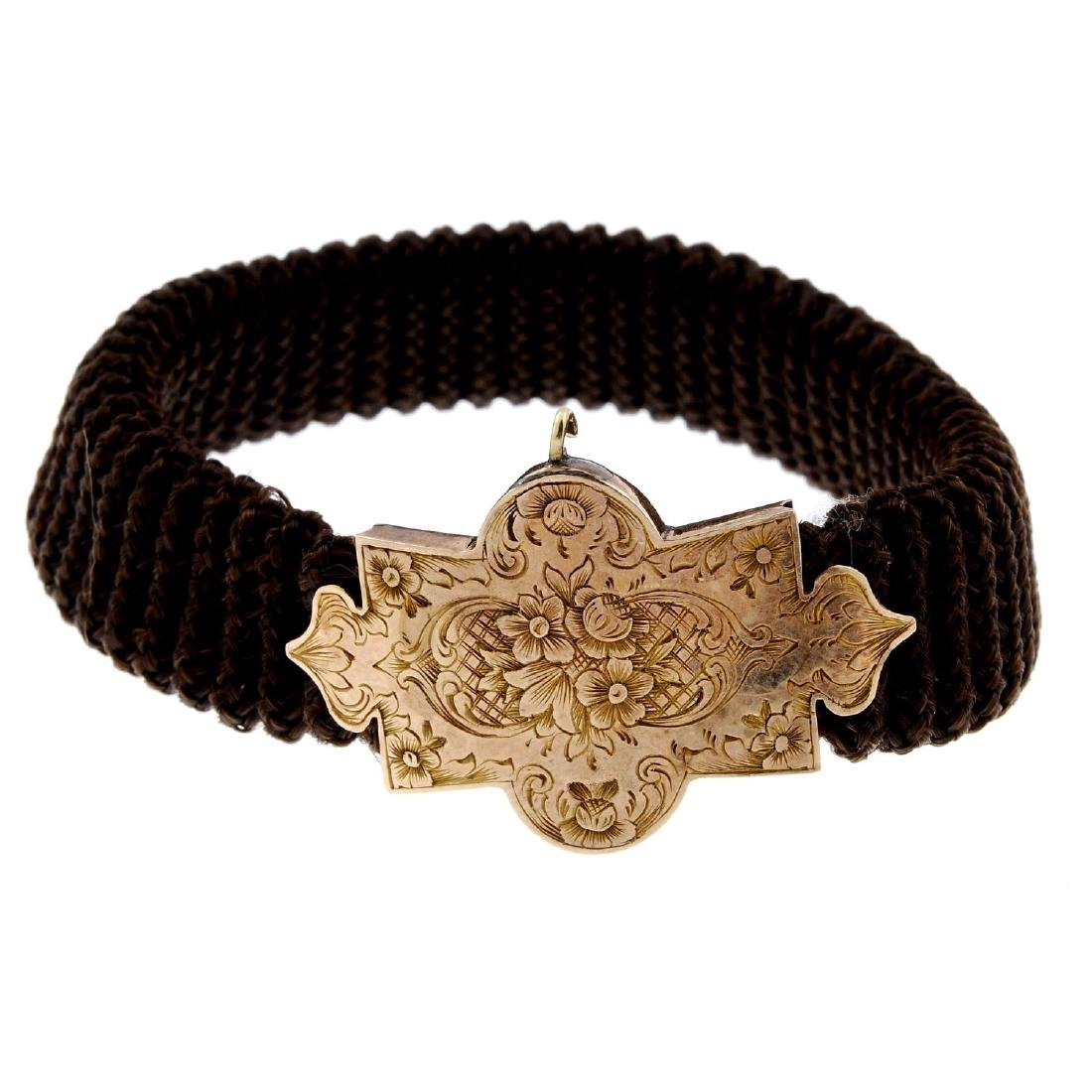 A mid Victorian memorial hair bracelet with 15ct gold