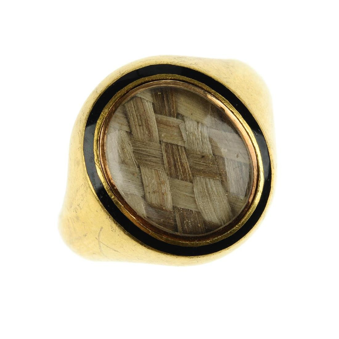 A late Victorian 15ct gold and enamel memorial ring. Of