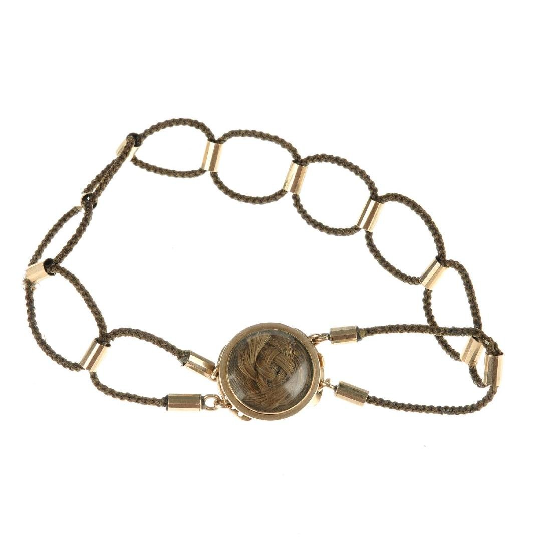 A late Victorian hair memorial bracelet. Of circular