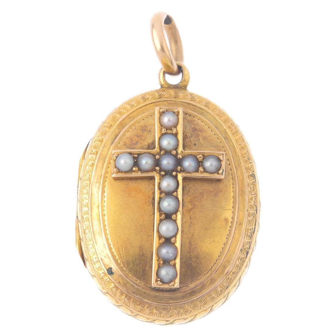 A late Victorian gold locket. Of oval outline, the