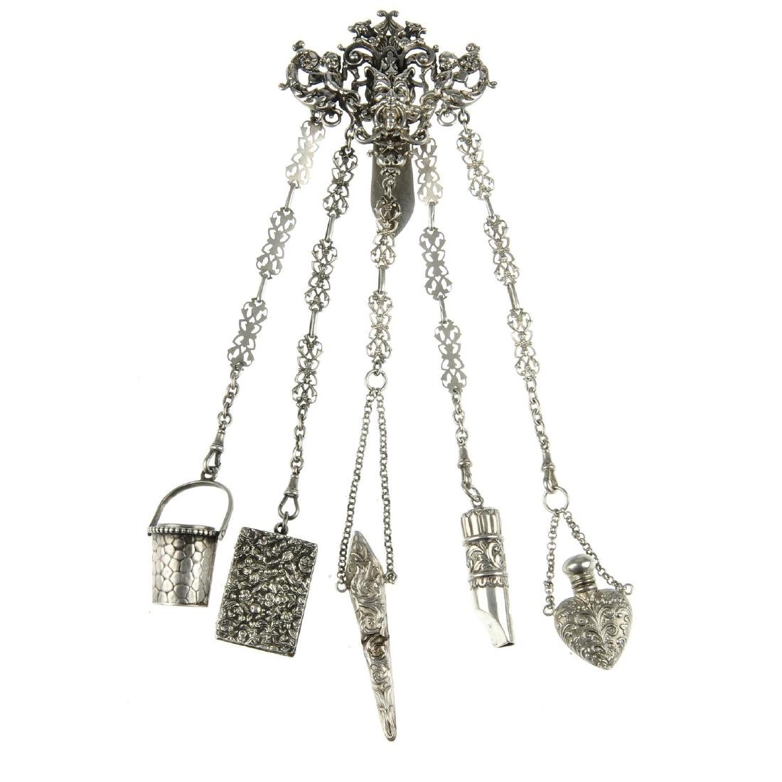 A late Victorian silver chatelaine. The upper section
