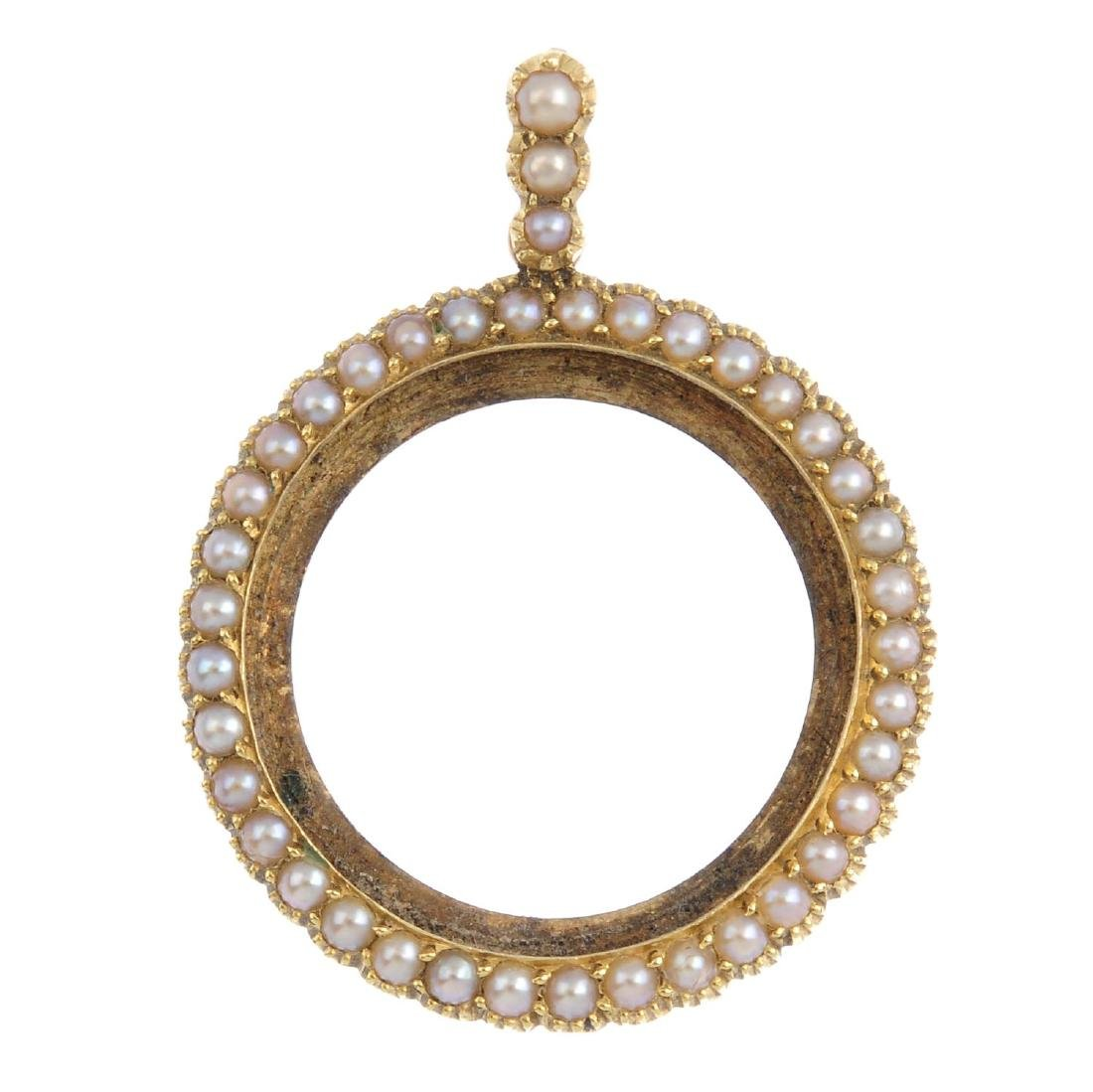 An early 20th century 15ct gold split pearl locket