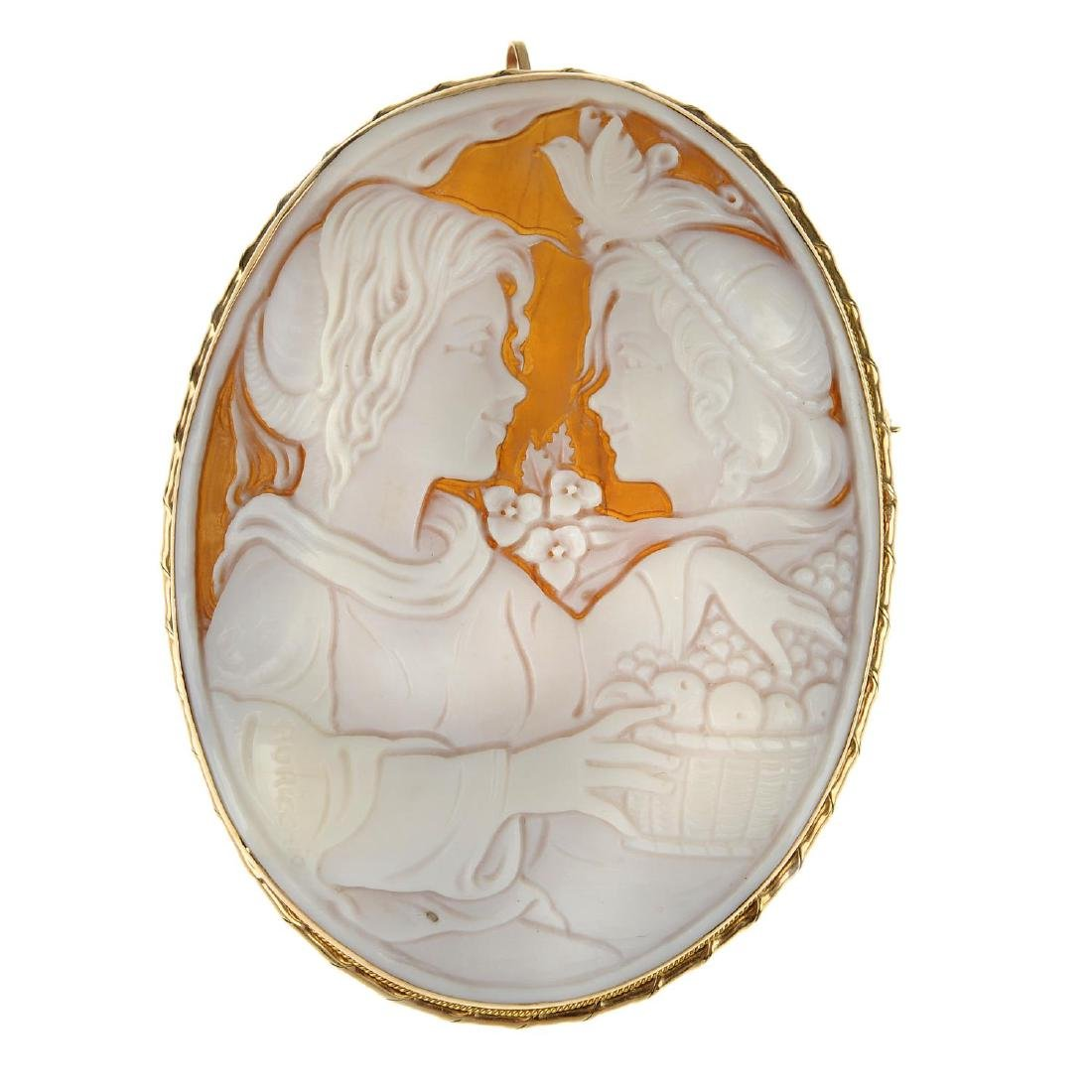 A cameo brooch. Of oval outline, depicting two young