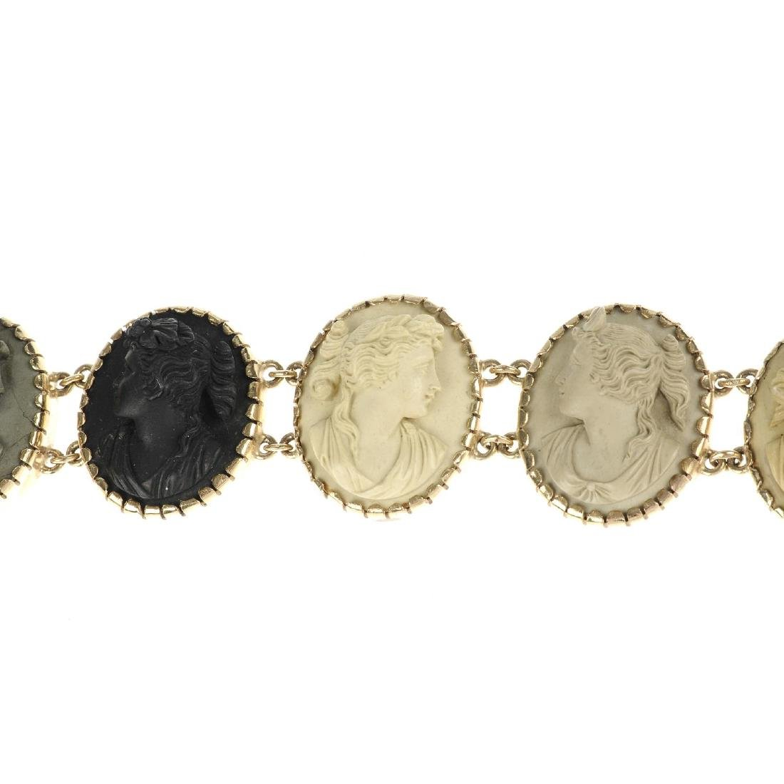 A lava cameo bracelet. The bracelet comprising six