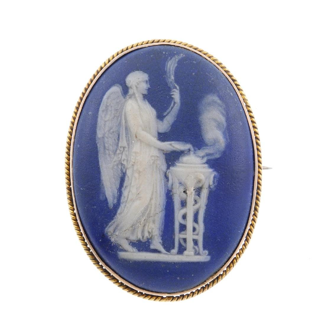 WEDGWOOD - a cameo brooch. Of oval outline, the blue