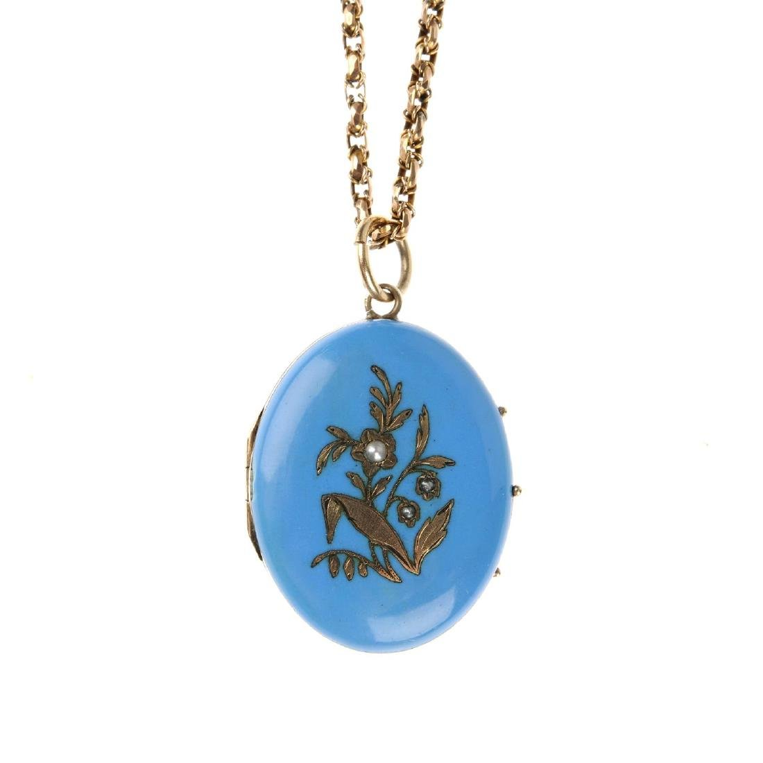 A late Victorian enamel and split pearl locket with 9ct