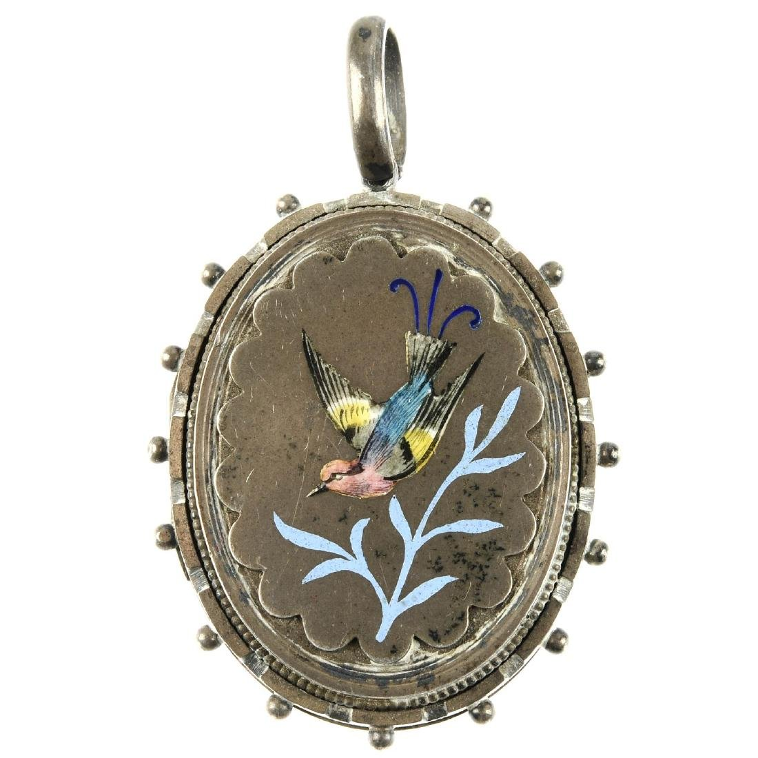 A late Victorian silver and enamel locket. Of oval