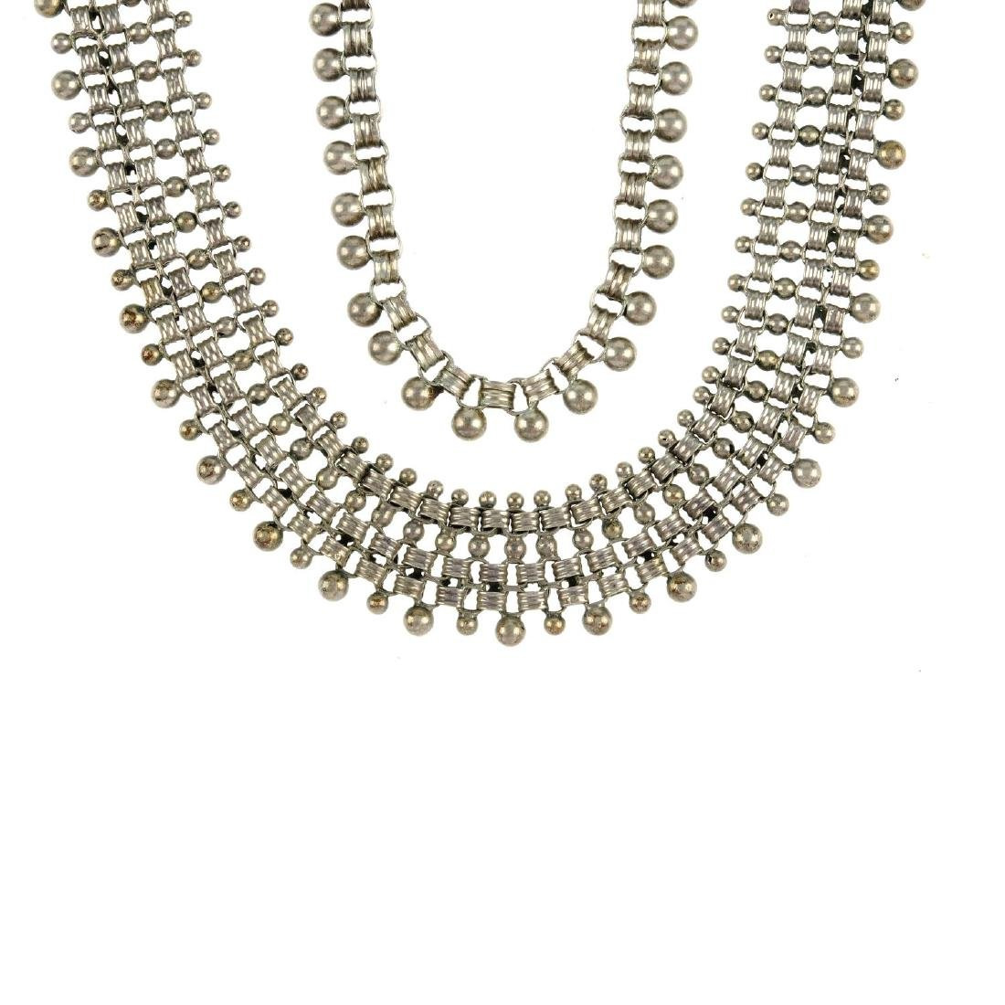 A late Victorian silver collar and part of a late