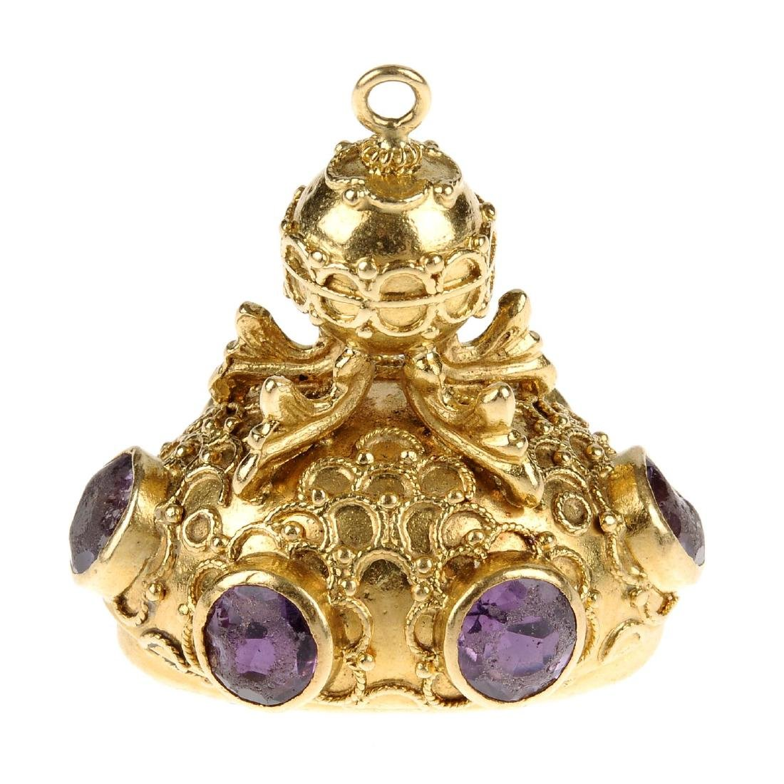 An amethyst fob. The oval-shape amethyst, to the