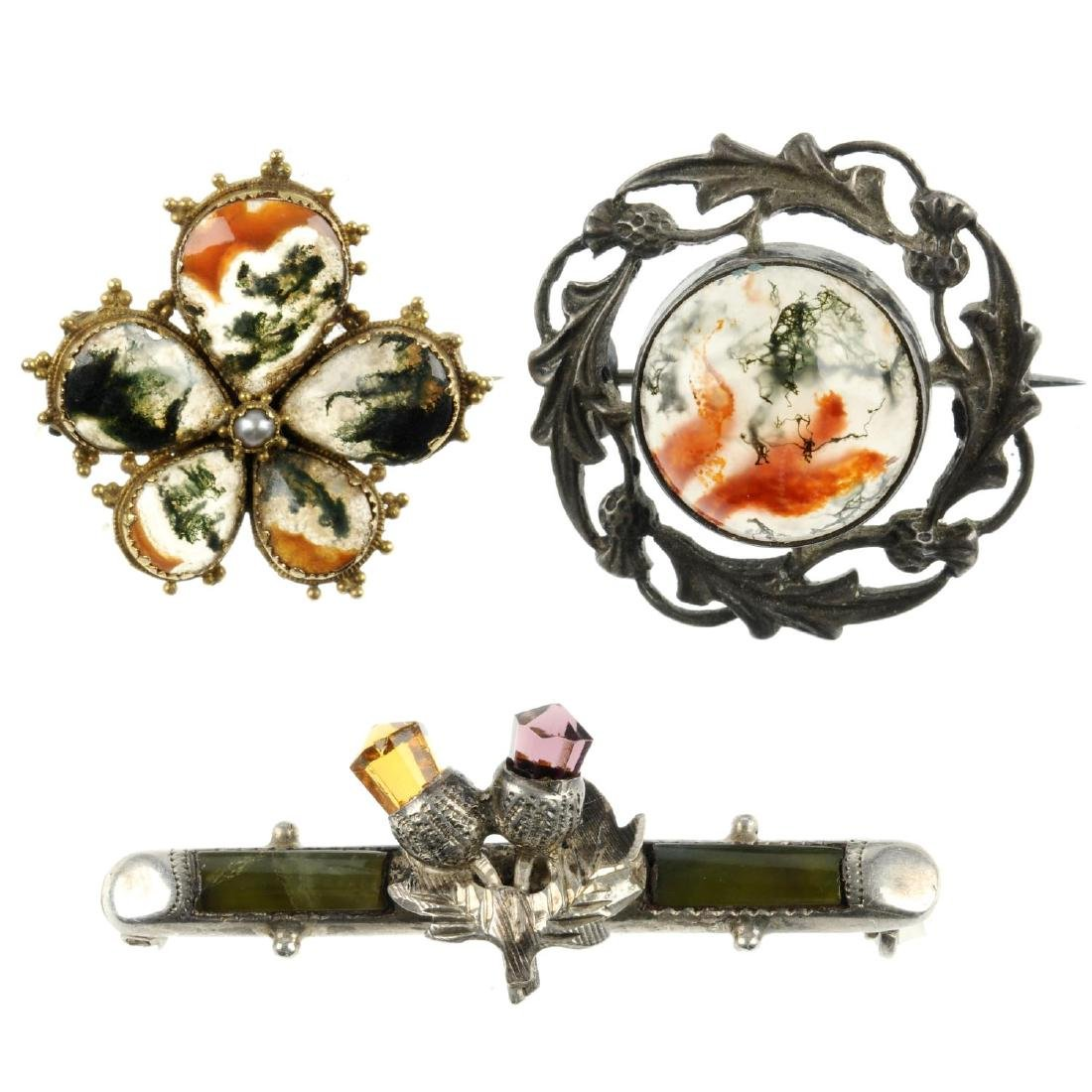 Five Scottish and agate brooches. To include one of bar