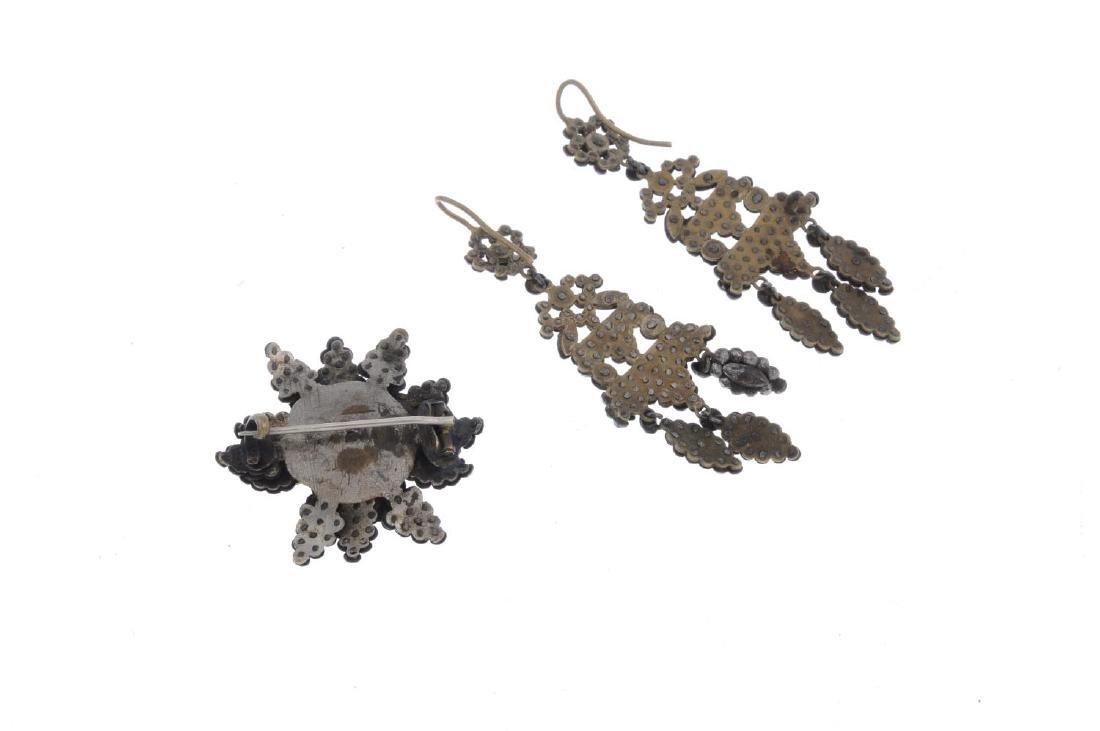 A cut steel brooch and earrings. The brooch of flower - 2
