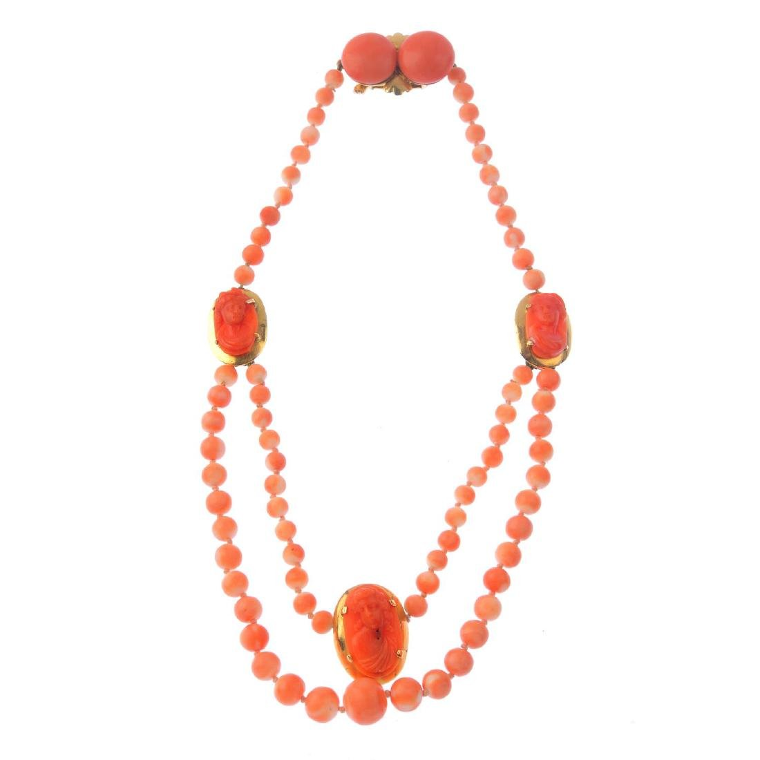 A coral necklace. The coral bead strand, with graduated