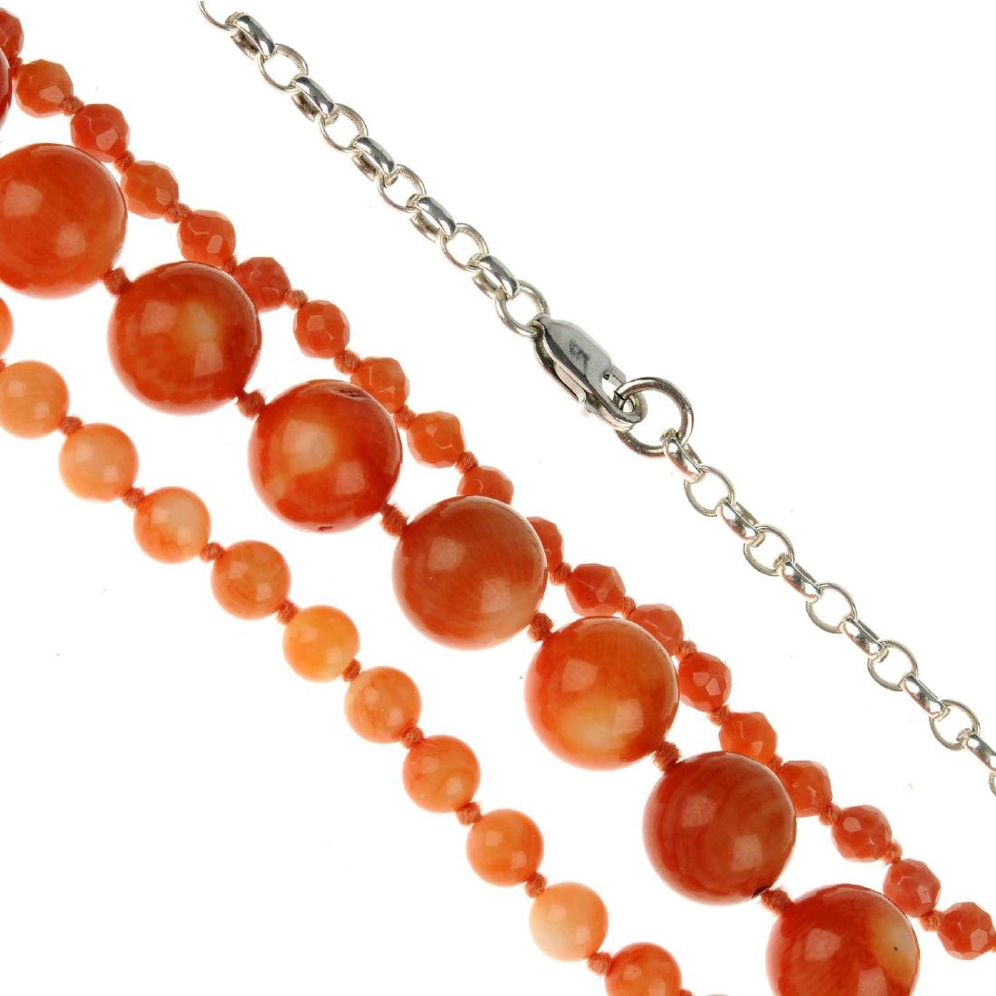 A three-row dyed coral bead necklace. Designed as a