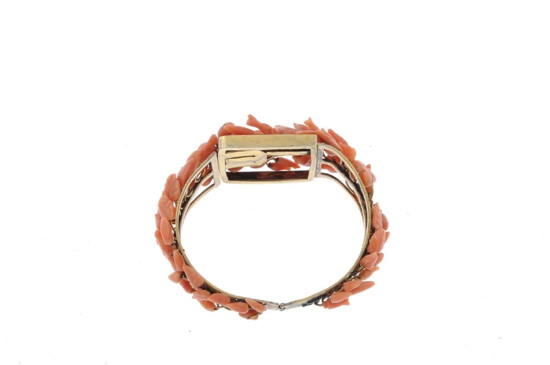 A coral bangle. The hinged bangle set with floral and - 2