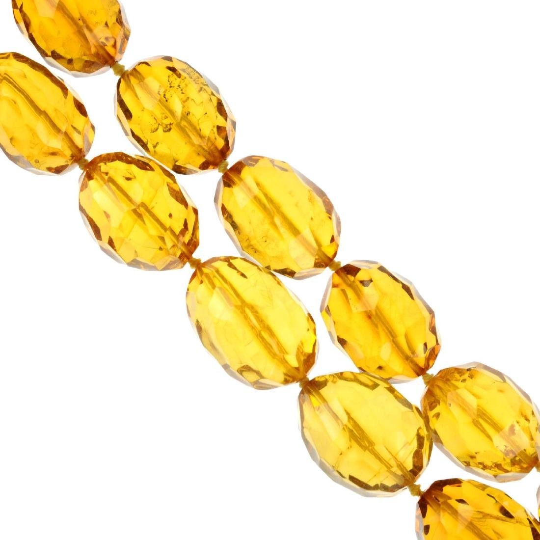 A faceted natural amber necklace. The graduated beads