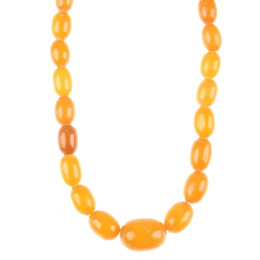 A natural amber bead necklace. Designed as graduated