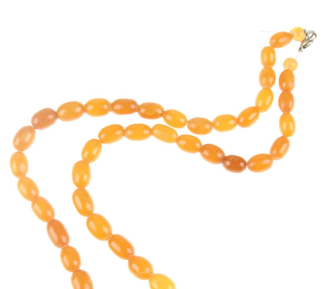 A natural amber bead necklace. Designed as graduated - 4