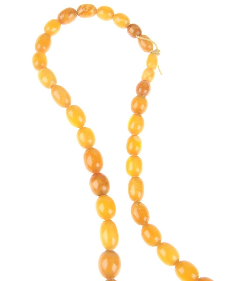 A natural amber bead necklace. Designed as graduated - 5
