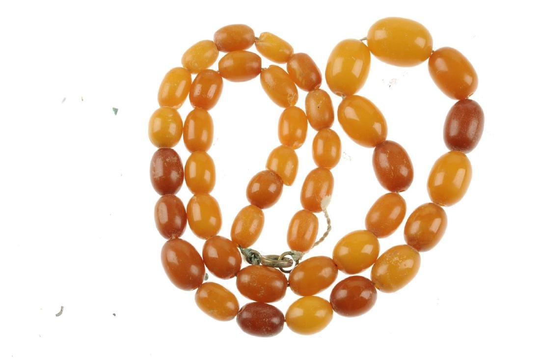A natural amber bead necklace. Designed as graduated - 2