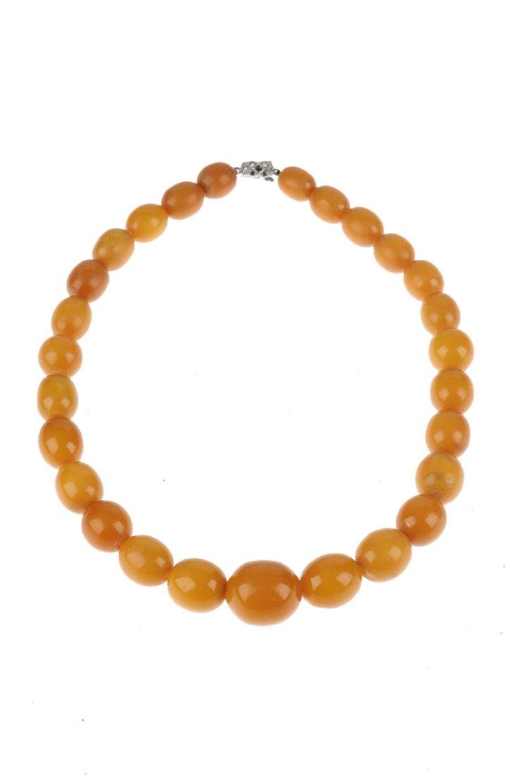 A natural Baltic amber necklace. Designed as a row of - 2
