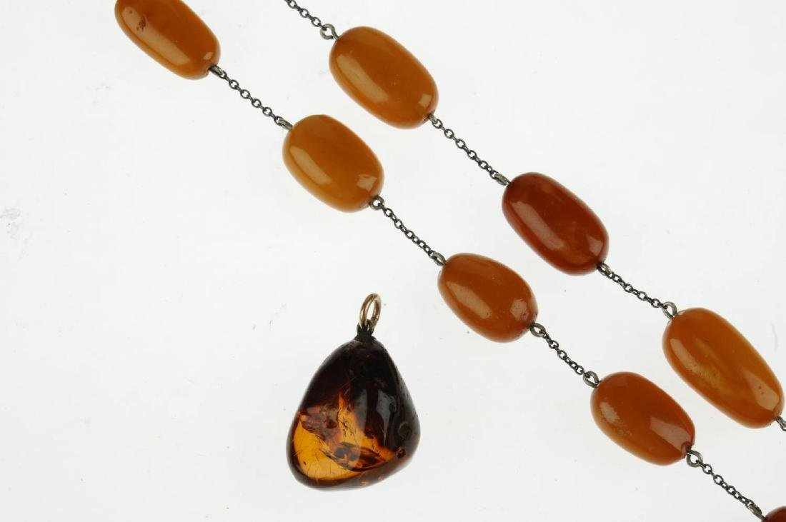 A natural amber necklace and pendant. The necklace