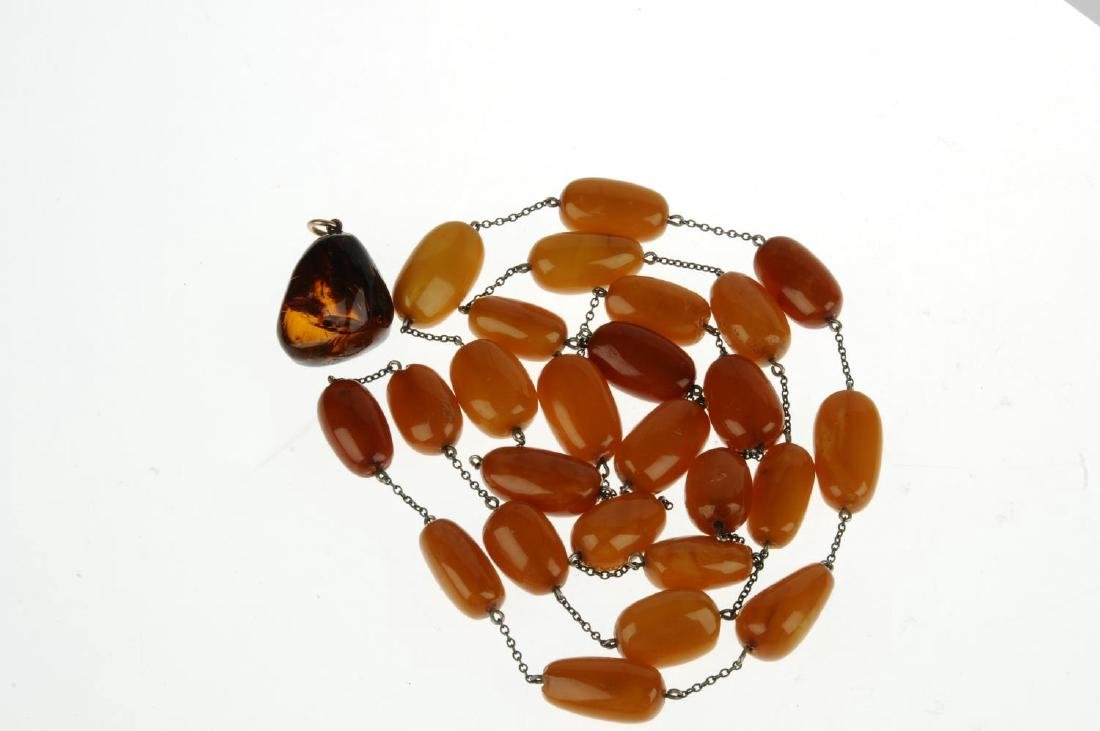 A natural amber necklace and pendant. The necklace - 2