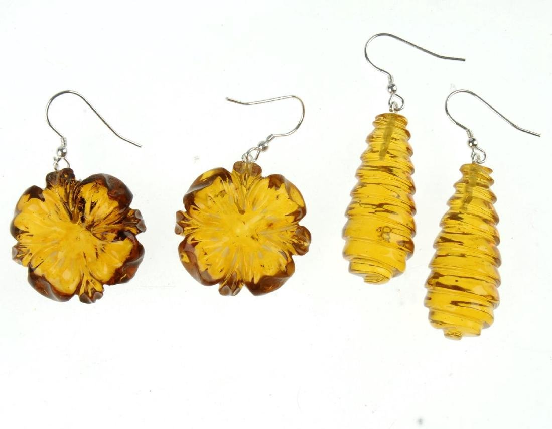 Two pairs of natural Dominican Republic amber earrings. - 2