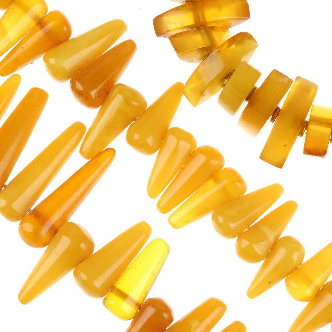 A selection of amber necklaces and a bracelet and two