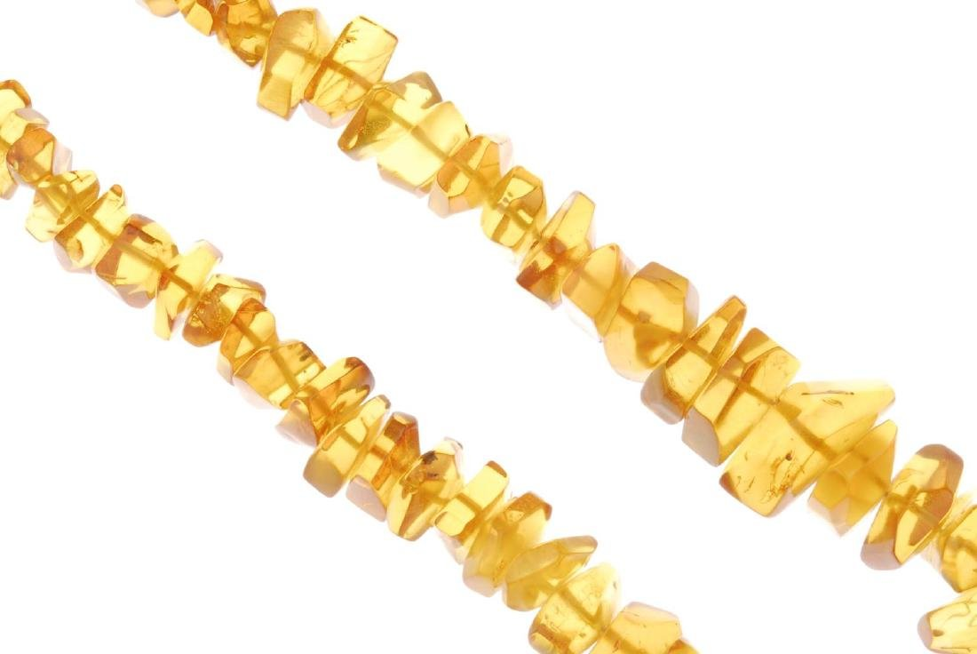 A selection of mainly amber jewellery. To include three - 3