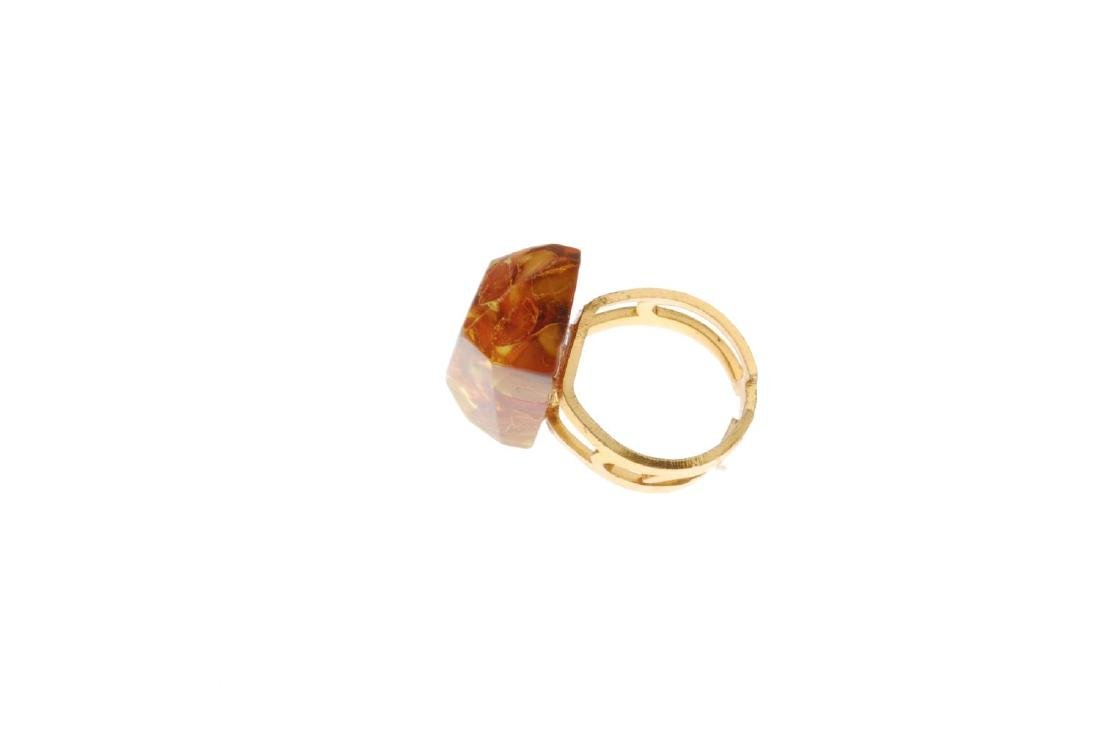 A selection of mainly amber jewellery. To include three - 9