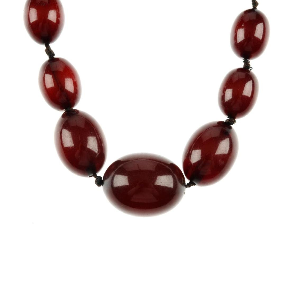 A bakelite bead necklace. Designed as a single row of