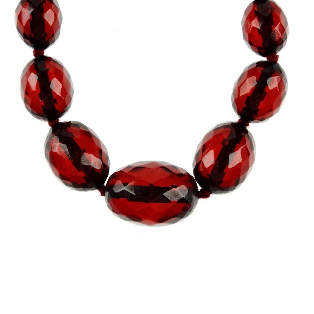 A bakelite necklace. Designed as graduated faceted