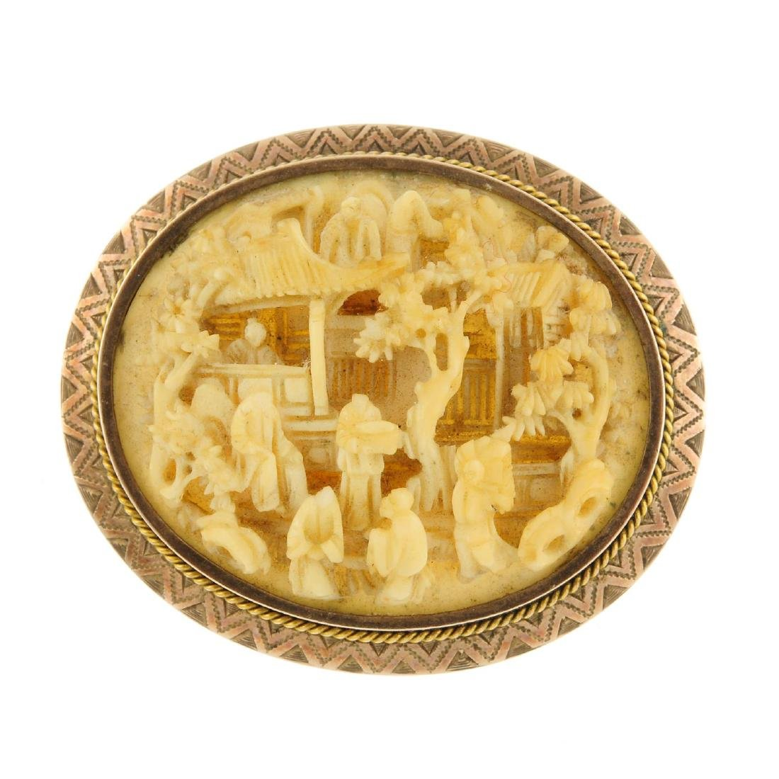 An early 20th century carved ivory brooch. The oval