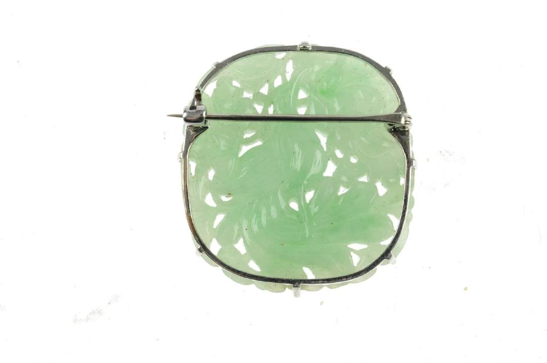 A carved jade brooch. Of cushion shape, the carved - 2