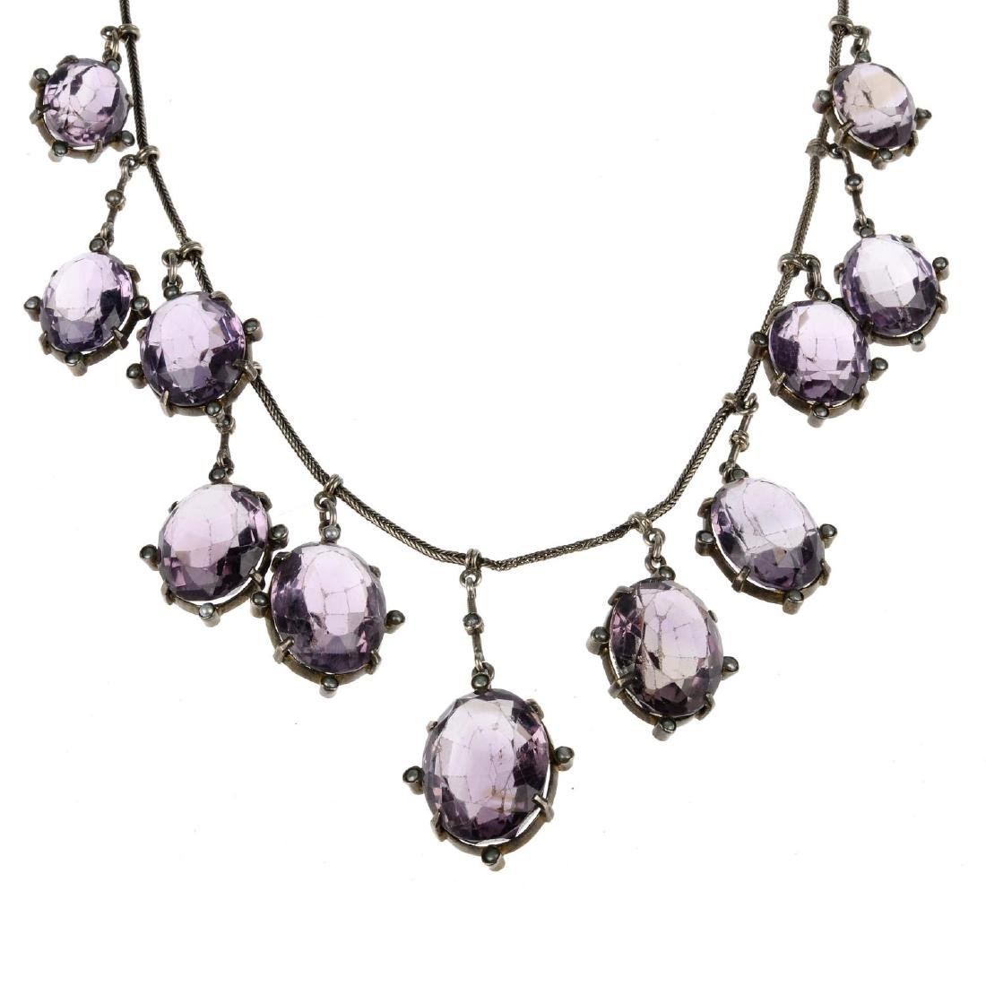 An amethyst and split pearl necklace. The herringbone